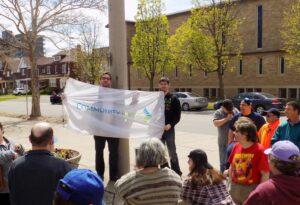 Brett Page and Mayor Friel raising the Community Living Flag