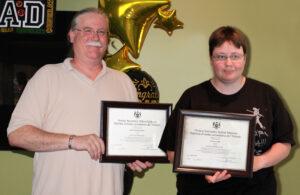 Jason and Kaleen holding up their award for graduating
